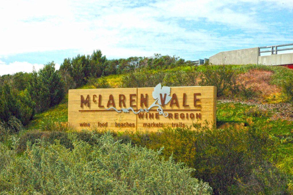 Sign for McLaren Vale wine region perched on a grassy hillside