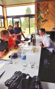 A group of 4 sharing a laugh and some lessons at the Geddes Wines.