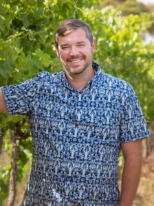 Jon Overcash, owner of My McLaren Vale Winery Tours standing in front of grape vines