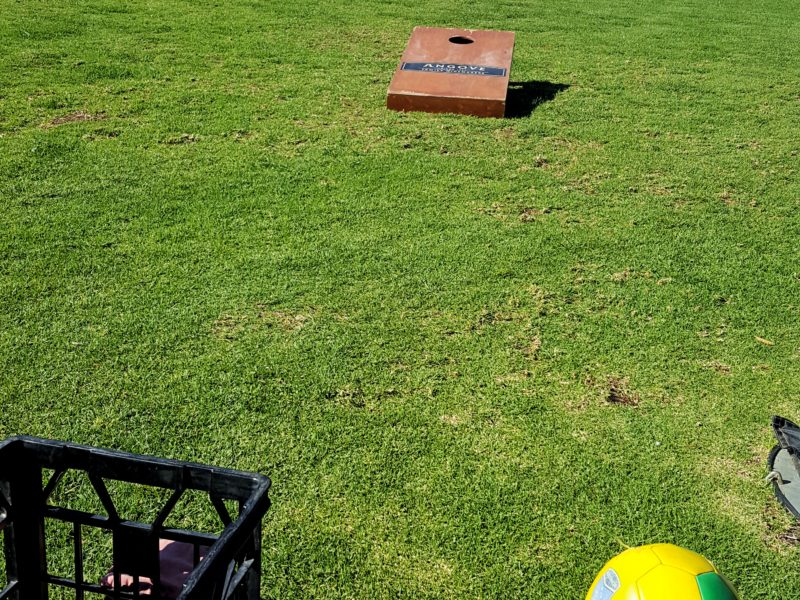 Cornhole and soccer ball at Angove
